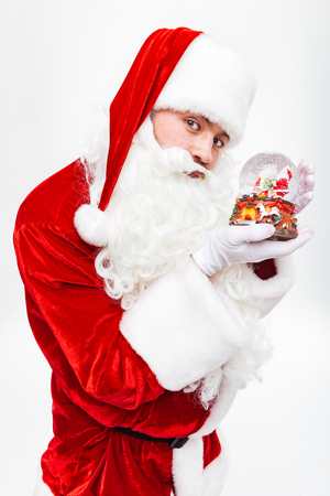 grandfather frost: Man santa claus standing and holding snow globe