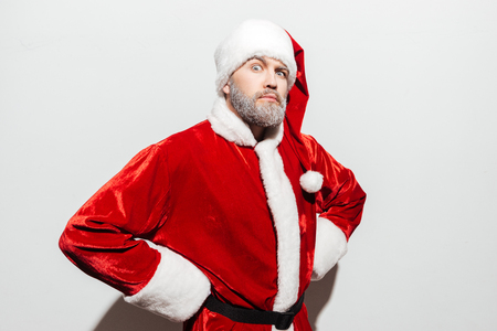 Confident strict man santa claus standing with hands on hips