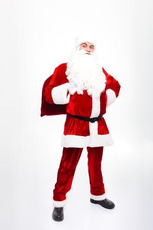 generosa: Smiling man santa claus standing and holding present sack