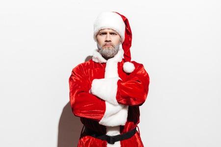 vestidos de epoca: Confident man santa claus standing with arms crossed