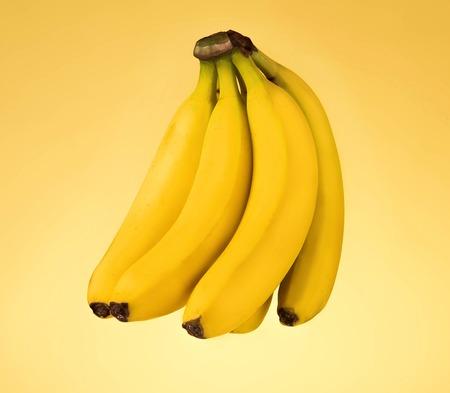 orange peel: Bunch of fresh bananas isolated on yellow background