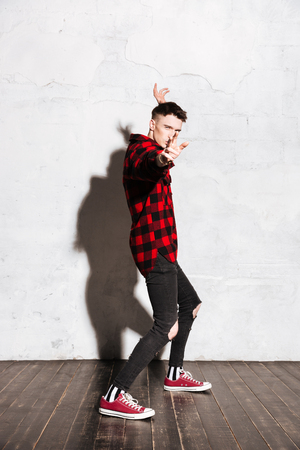 supercilious: Side view of Hipster prepares for battle. Vertical image. Full length portrait