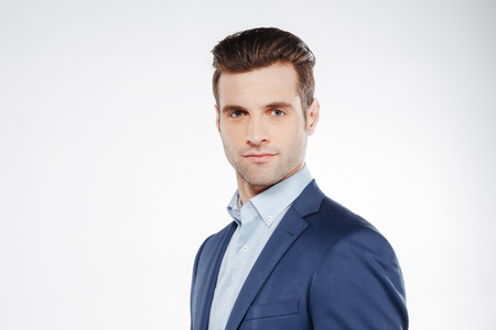 Business man which standing sideways and looking at camera Stock Photo