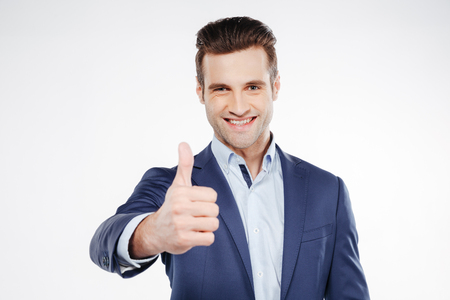 Portrait of business man which showing thumb up and looking at camera. Focus on face Stockfoto