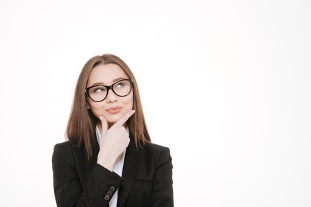 Thoughtful smart business woman smiling and looking up at copy space over white background