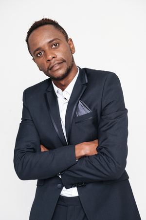 Picture of african businessman posing in studio. Isolated over white background. Look at camera.