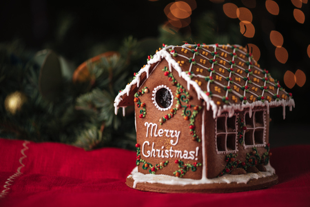 Closeup of gingerbread house decorated inscription Merry Christmas Stock Photo