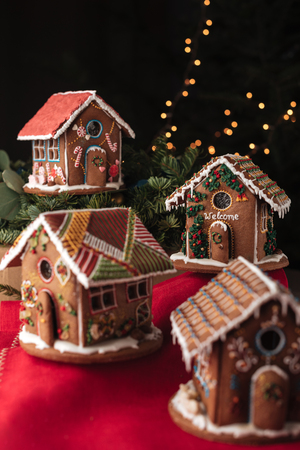 gingerbread: Four gingerbread houses decorated with glaze Stock Photo