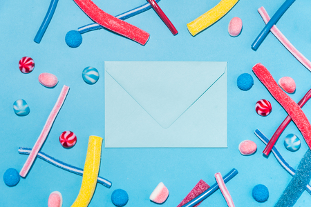 Sweet jelly licorice candy sticks and lollies with different flavor isolated on blue background Stock Photo