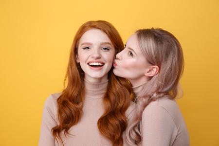 Blonde teens kissing display write