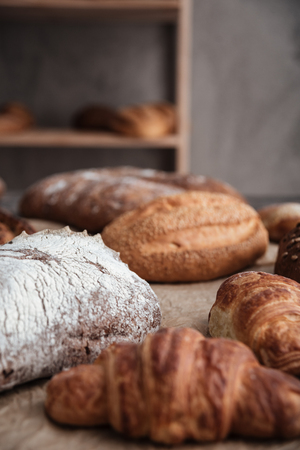 buttery: Photo of pastries and bread with flour on table at bakery