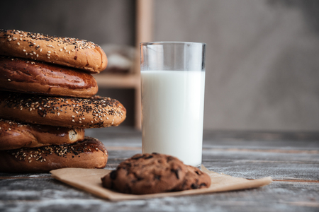 buttery: Image of pastries on dark wooden table with milk and cookie at bakery