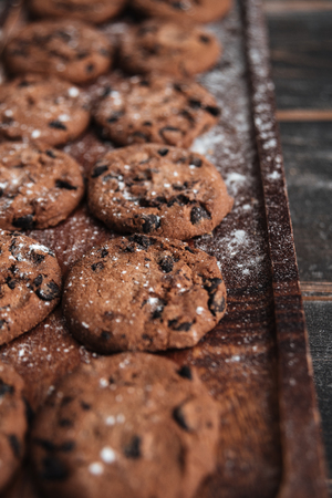 buttery: Image of cookies on desk on dark wooden table at bakery