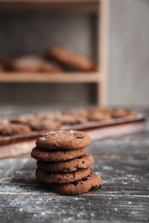Image of cookies on desk on dark wooden table at bakery