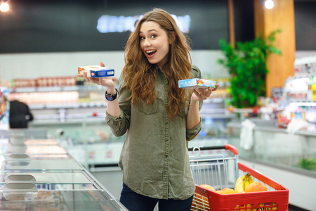 Young woman make a succesful choice between two products in mall Stock Photo