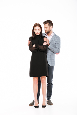 Picture of offended young loving couple swear isolated over white background. Man ask for apologize. Stock Photo - 78480797