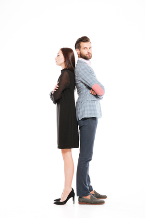 Photo of young offended loving couple standing isolated over white background. Stock Photo