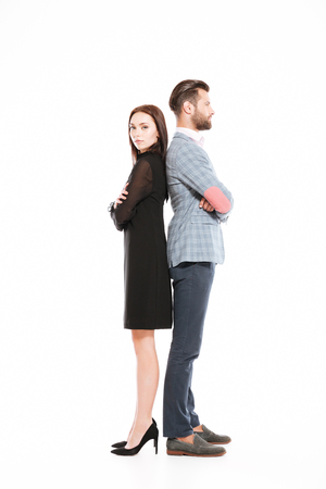 Image of young offended loving couple standing isolated over white background. Stock Photo - 78517037