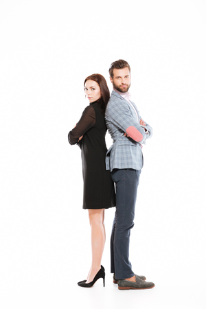 Image of young offended loving couple standing isolated over white background. Looking at camera. Stock Photo - 78495561