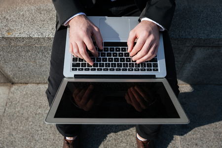 blank screen: Close up of blank screen of laptop in hands of businessman