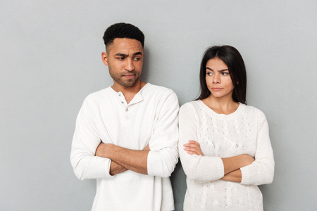 Couple of angry young man and woman about each other isolated