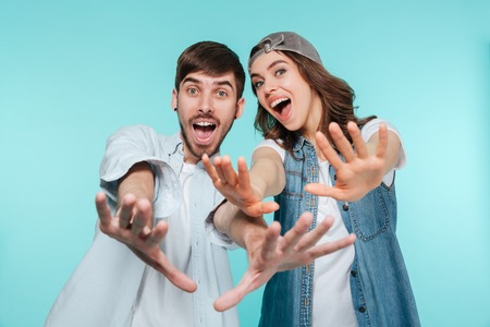 Happy family brother and sister smiling and stratching out hands isolated Stock Photo