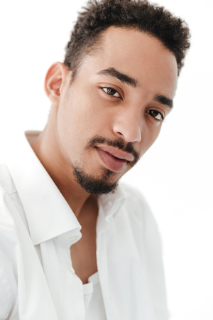concentrate: Picture of handsome young african man isolated over white background. Looking at camera.