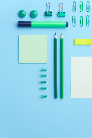 Top view image of office supplies on the blue background table Stok Fotoğraf - 80123879