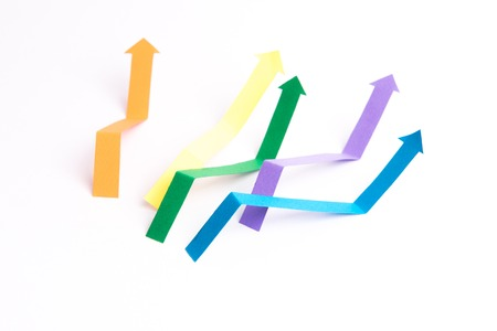 Photo of business graphics arrows isolated over white background. Imagens