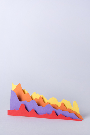 Picture of business graphics isolated over grey background.