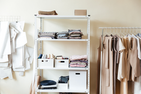 Image of clothes and fabrics on shelves in workshop