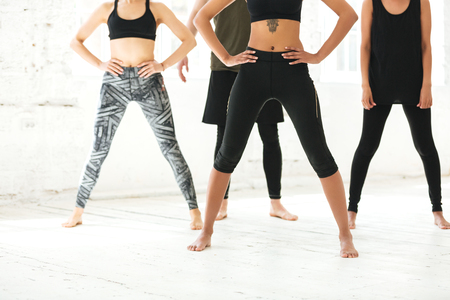 Cropped image of a mixed group of people exercising together in a gym Stock Photo