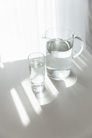 Picture of water jug on white table indoors