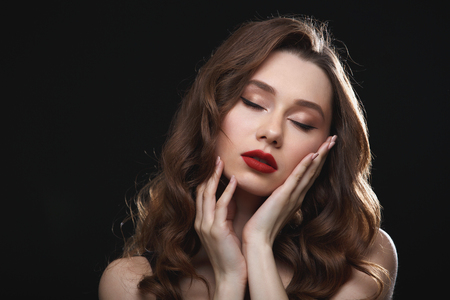 Tender attractive young woman with red lips and closed eyes Stock fotó