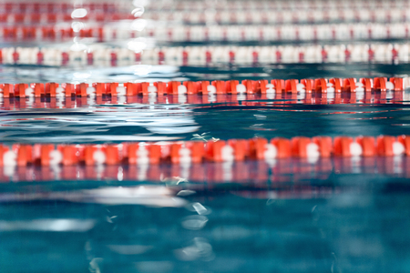 Close up side view of swimming lanes in a swimming pool