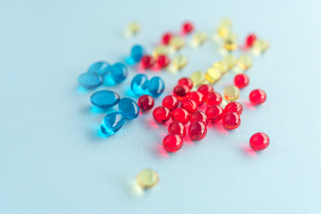 Heap of colorful gel capsules isolated Stock Photo