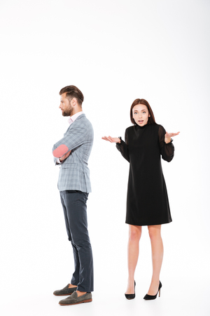 Photo of offence young loving couple standing isolated over white background. Stock Photo - 82155383