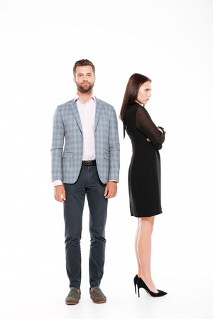 Photo of offence young loving couple standing isolated over white background.