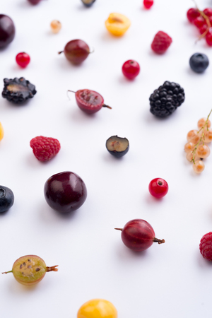 Top View Image of mix of berries isolated over white background table. Stock Photo