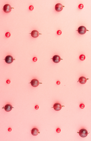 Top View Image of mix of berries isolated over pink background table.
