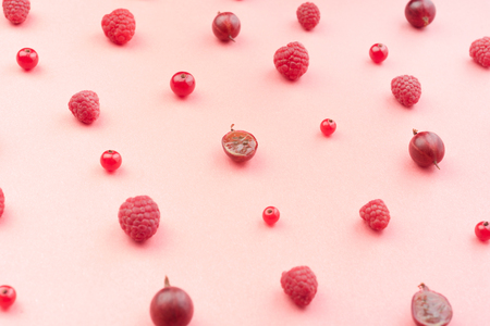 Top View Picture of mix of berries isolated over pink background table.