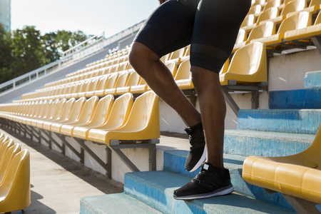 Cropped image of a young mans legs walking down the stairs at the stadium
