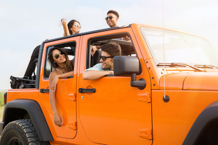 Group of happy young people laughing and having fun on a road trip Stok Fotoğraf