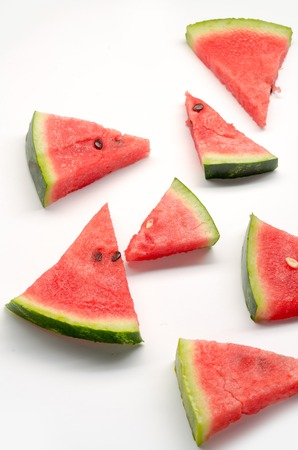 berry: Different triangle pieces of red ripe watermelon on white background Stock Photo