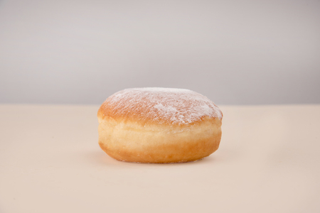 Side view of delicious white donut with powder isolated over white Reklamní fotografie