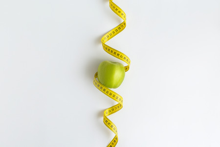 Fresh green apple with measuring tape isolated on white background Reklamní fotografie
