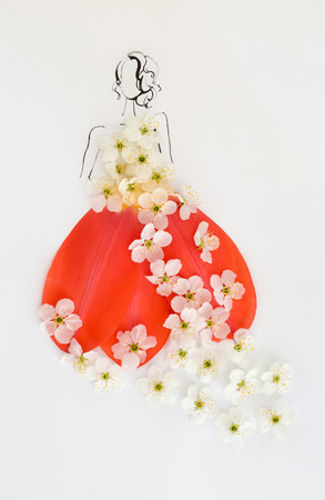 Hand drawn beautiful female silhouette wearing dress made of blooming white flowers and red tulip petals isolated over white. Fashion illustration