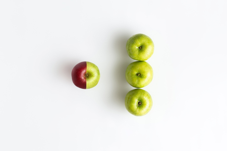 Top view of an apple combined from two half of red and green color. Trend of environment change or modified concept