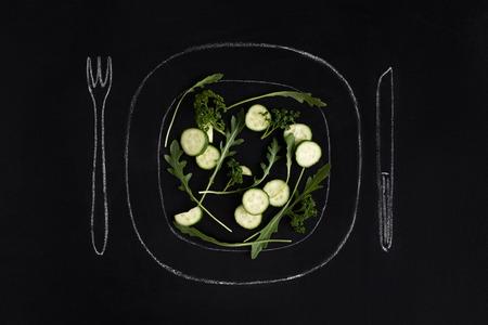 Fresh vegetables salad on a drawn plate. Beautiful hand drawn illustration. Editable  image. Фото со стока