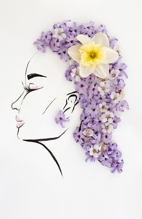 Hand drawn beautiful female profile with natural narcissus flower hairstyle isolated over white. Fashion illustration Stock Photo